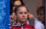 "Russian skater Julia Lipnitskaia receiving an ""Ear Rub"" from her coach prior to her routine.  (via Yahoo Sports)"